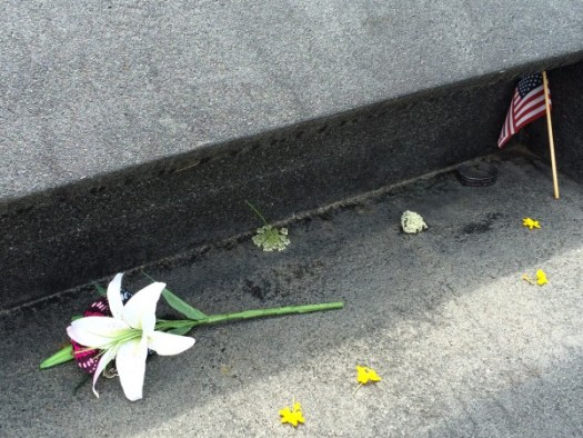 Floral tributes left along the wall
