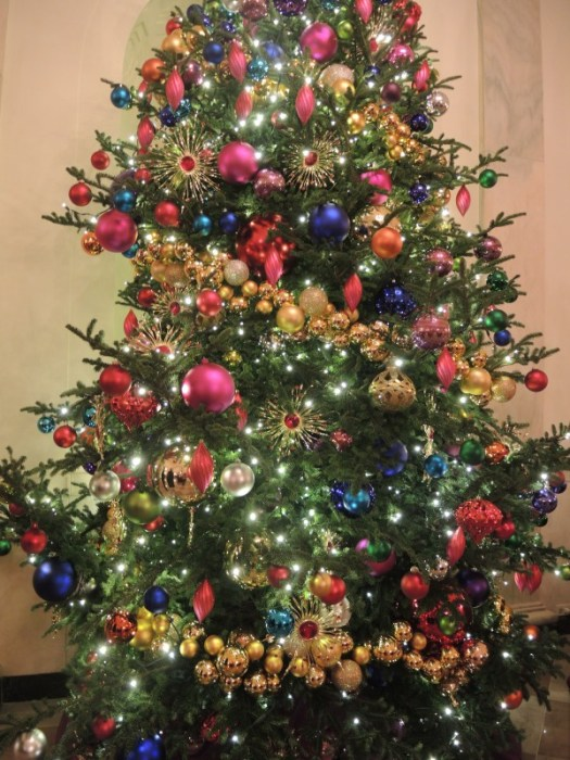 grand foyer trees with giant ornaments in jewel tones - Jewel Colored Christmas Decorations