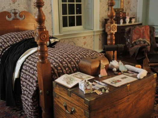 One of the bedrooms with toys that were used in the time period