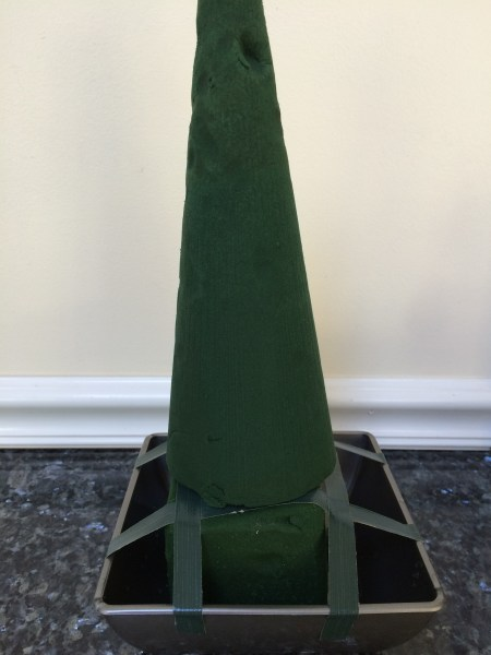 Insert an oasis cone on top of the picks; you can also add a large block of oasis and shave it into a cone shape