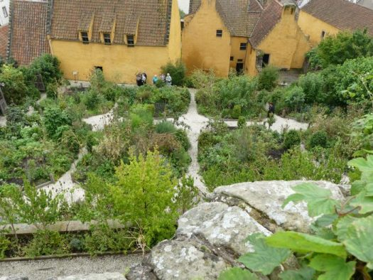 Claire's Outlander herb garden is neatly divided by gravel pathways