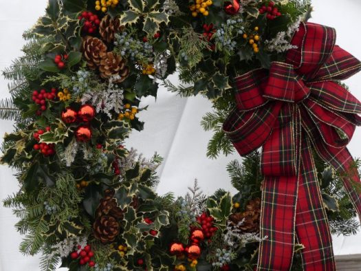 The plaid ribbon give this wreath a down home look