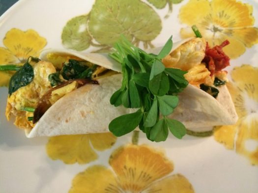 Pea shoots garnishing a tortilla