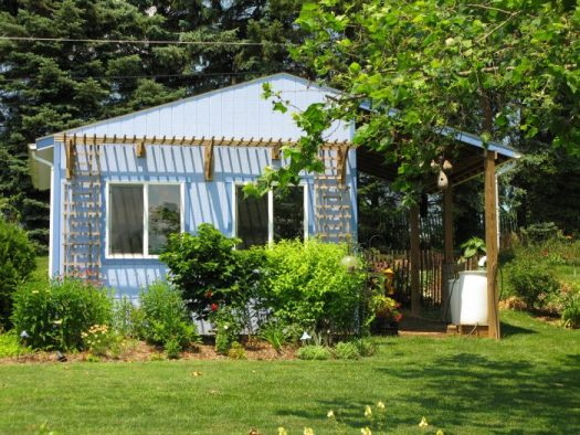 My cornflower blue potting shed is located next to my veggie garden as well as close to the house and the compost pile