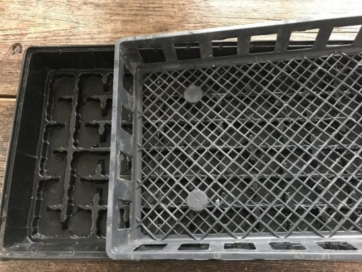 Use two flats that fit together, one perforated for drainage, the bottom one solid