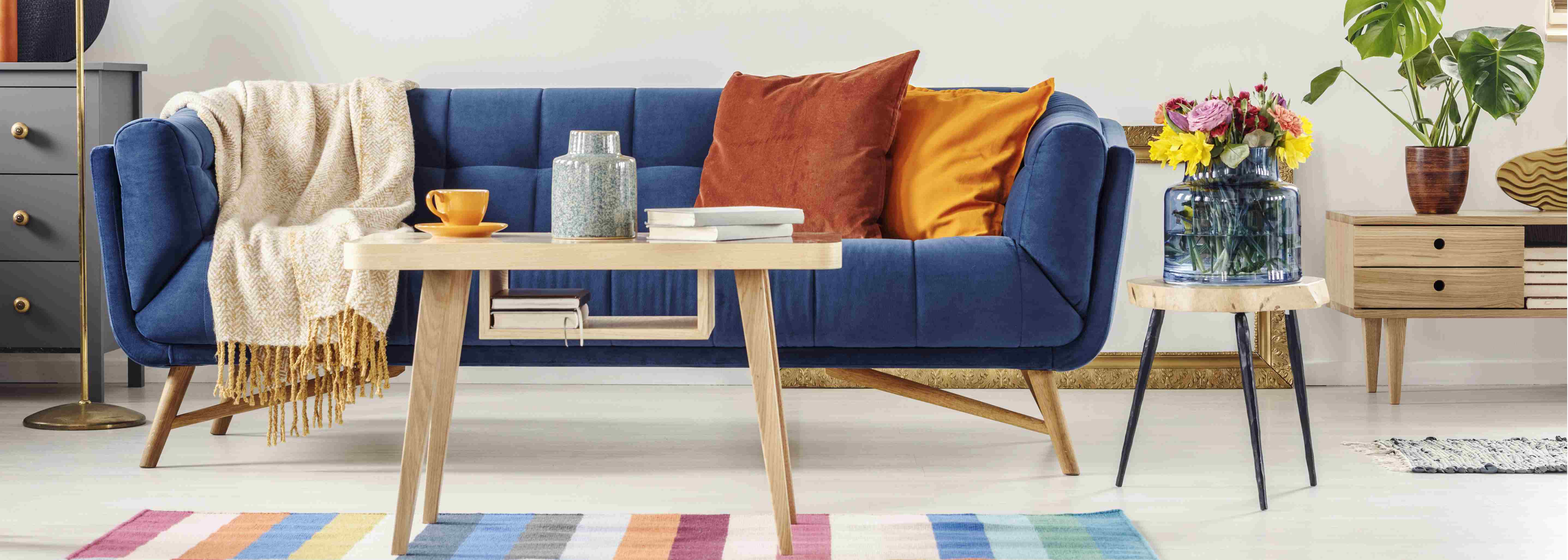 blue settee with orange pillows