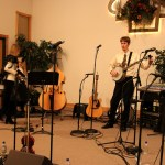 Our banjo player tuning. What else would a banjo player be doing? ;) (Verndale Alliance Church)