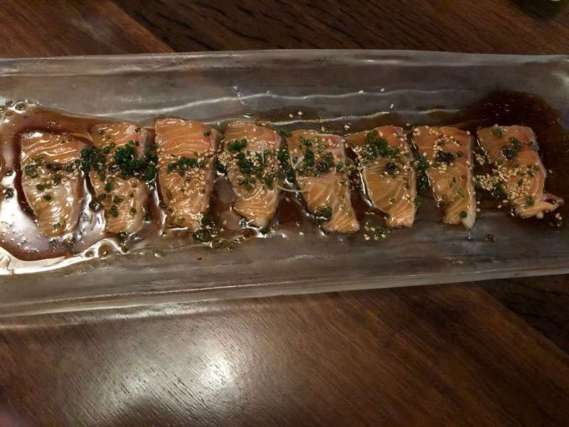 Salmon with a truffle ponzu and hot sesame