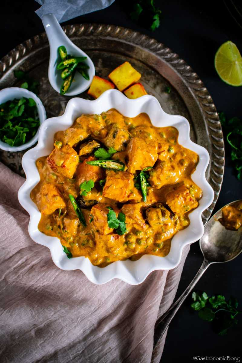 Mushroom Matar Paneer a rich and creamy curry is made with fresh mushrooms, green peas (matar) and paneer simmered in luscious & spiced onion-tomato gravy.