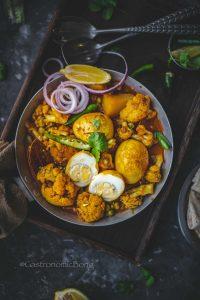 Dim Phulkopir Dalna (Bengali Egg curry with Cauliflower)