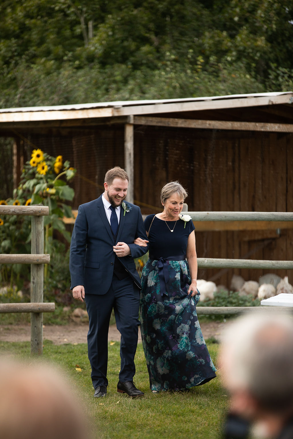 groom and his mom walk down the aisle of this outdoor farm wedding ceremony. www.thegathered.ca