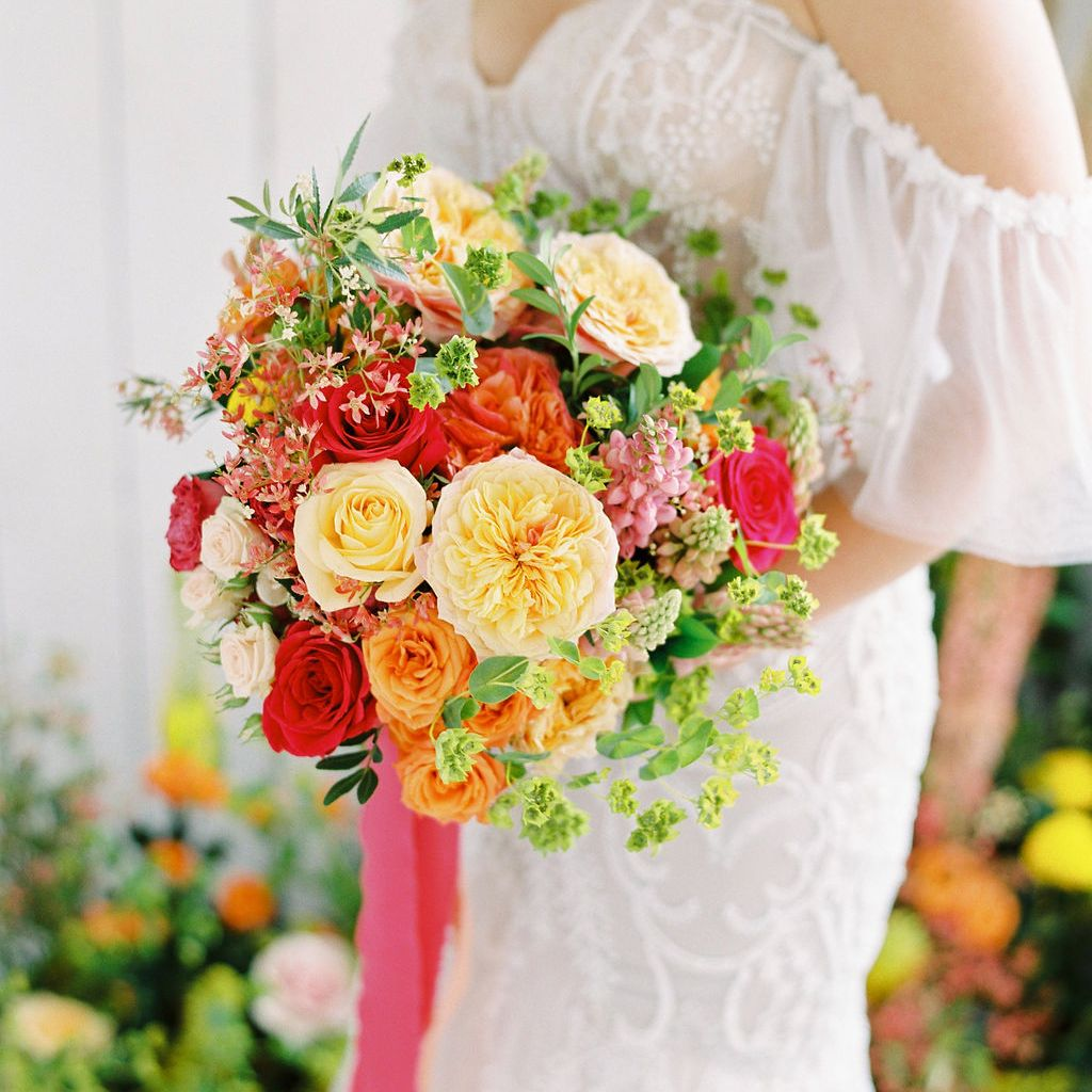 bold floral bouquet with reds, yellows and oranges make the spring colors pop with warmth and boldness