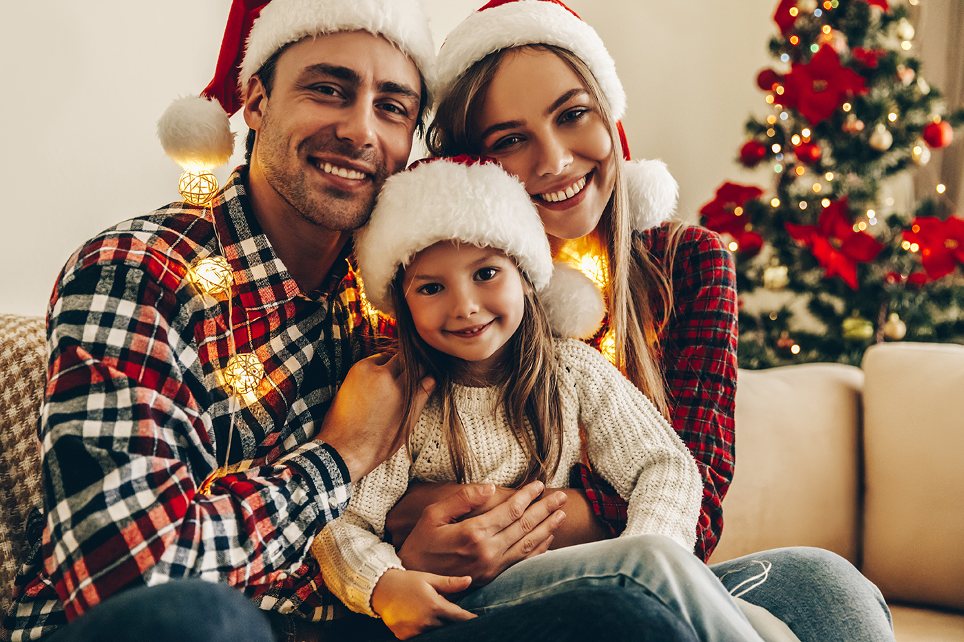 family smiling during christmastime