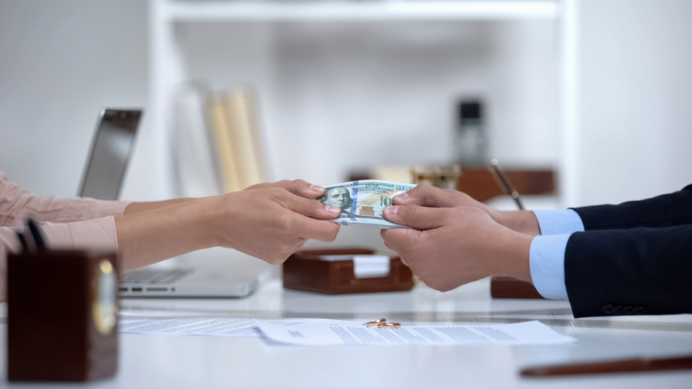 divorcing couple fighting over marital assets and money