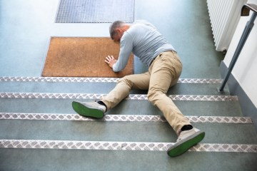 man slip and fall on stairs