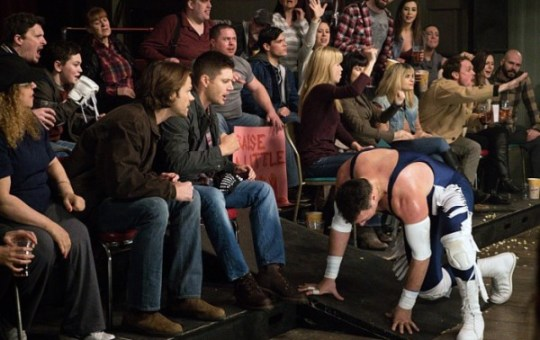 Supernatural: Beyond the Mat - Dean and Sam sit in the stands and cheer on fallen wrestler Gunner Lawless