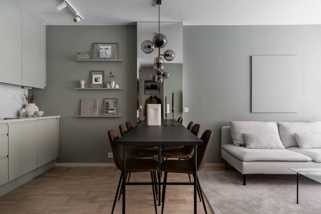 open plan living area with sage green walls dining room