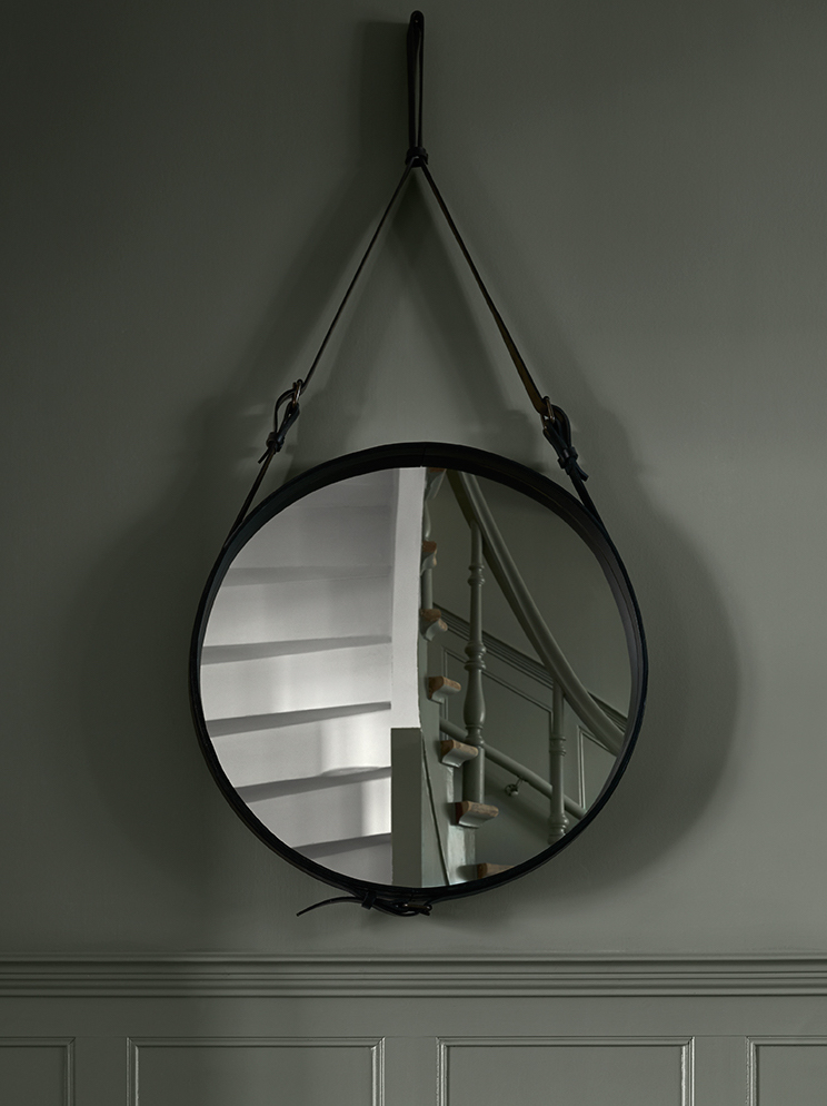 rounded mirror in a hallway