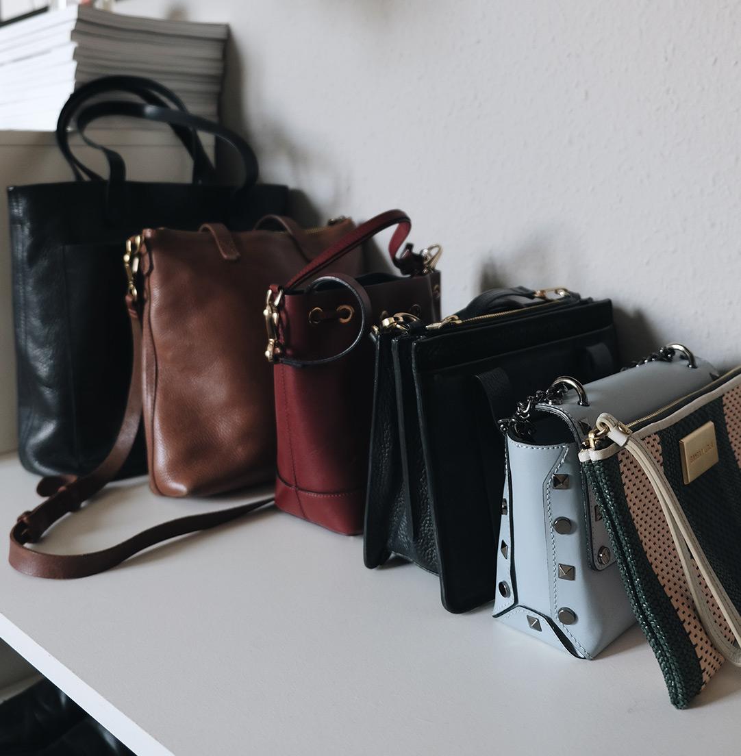 small space closet organization: bags on shelf