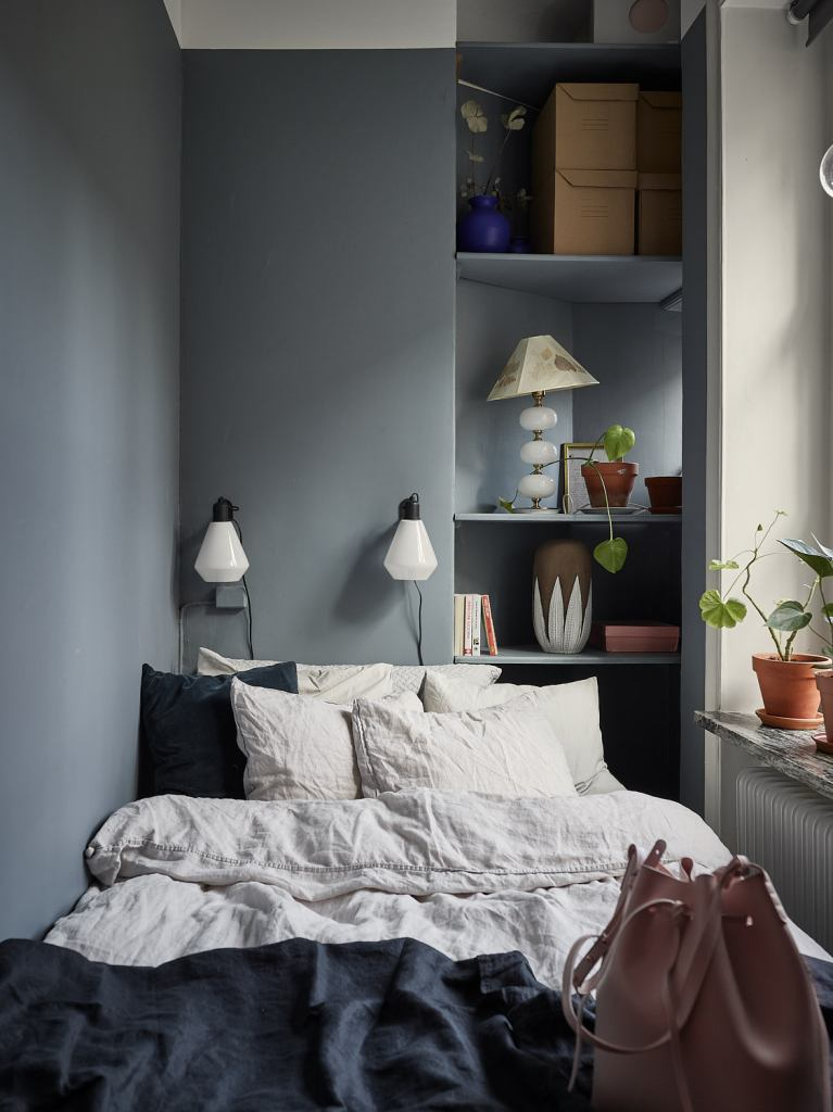 small bedroom blue and shelves