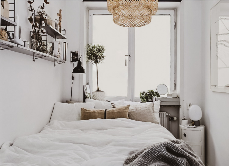 small bedroom with sumperimposed lights