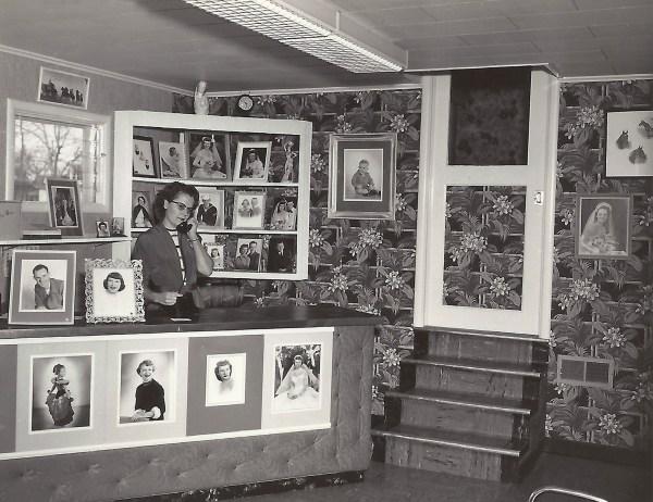 Estelle Duval at the desk of Duval Portraits, 1 April 1954
