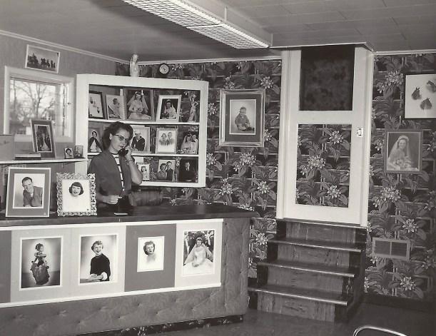 Estelle Duval at the desk of Duval Portraits