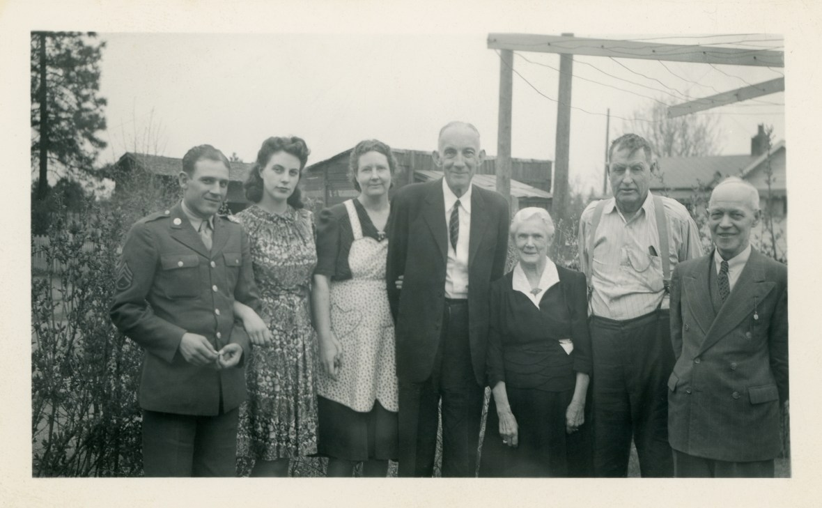 YOUNG, James at far right and wife Catherine is third from right