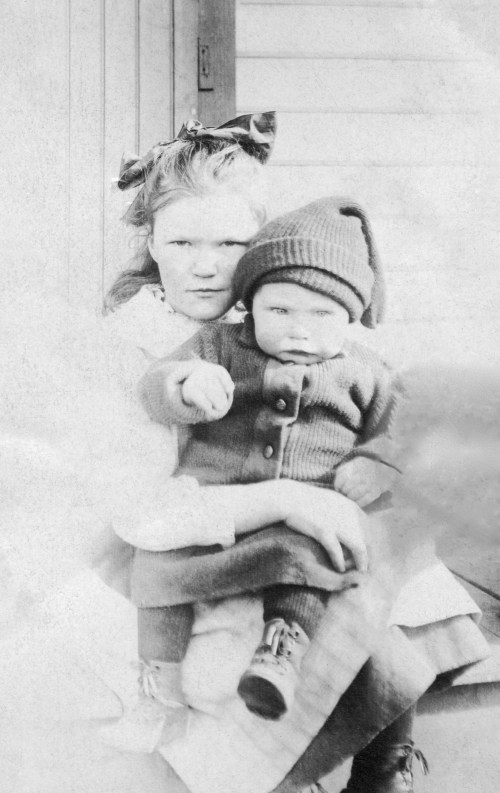 YOUNG, Mary Brown holding brother