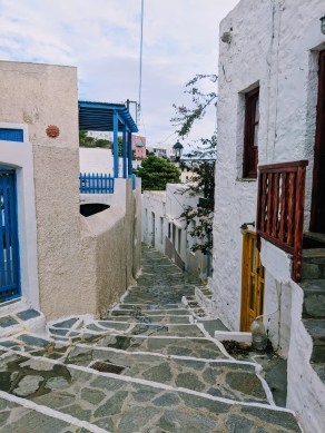 Narrow cobblestone street in Plaka village at Milos, Greece.
