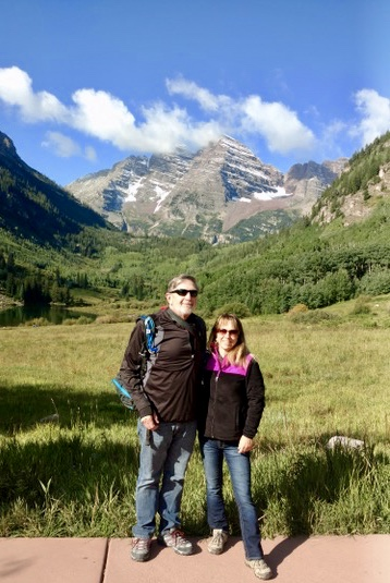 Couple in front of maroon bells Colorado