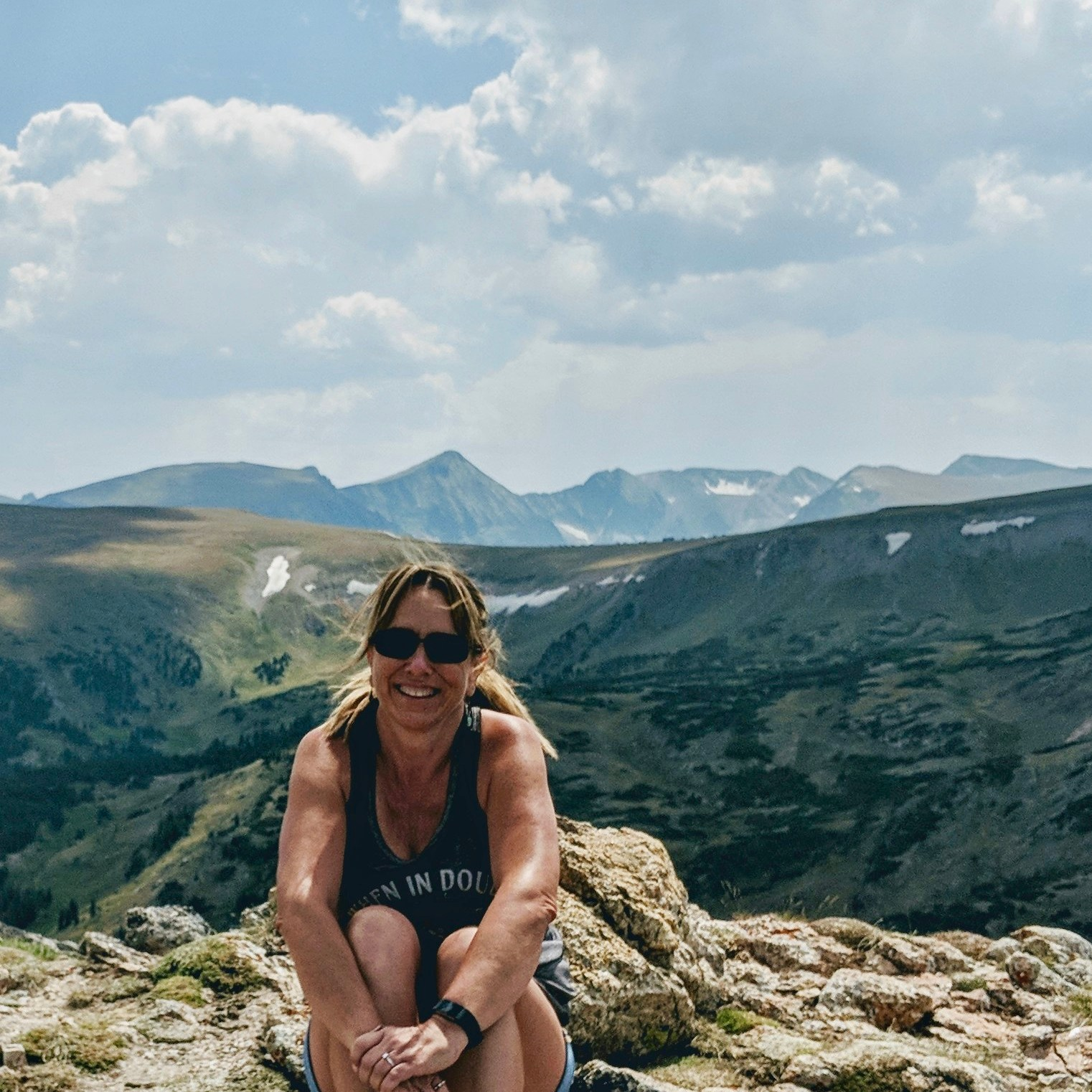 Girl sitting on rock at Rocky Mountain National Park