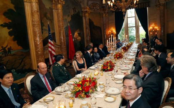 Donald Trump sits down to dinner after giving the order to bomb a Syrian air base CREDIT: AP