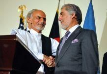 Ashraf Ghani shakes hands with Abdullah Abdullah