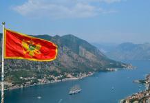 Montenegro Flag waving over Koto