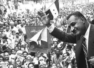 Former Egyptian President Gamal Abdel Nasser waving to crowds in Mansoura from a train car