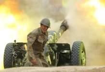 Armenian solder firing artillery