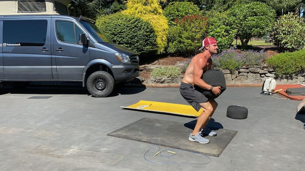 Joe doing sandbag cleans in the driveway