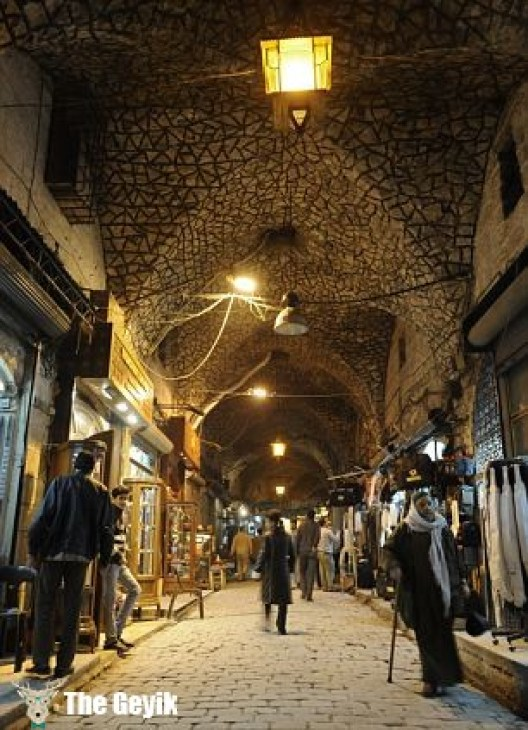 30 Sep 2012, Aleppo, Syria --- People walk through the Al-Madina Souq market in Aleppo in this March 3, 2011 file photo. Hundreds of shops were burning in the ancient covered market in Aleppo on September 29, 2012 as fighting between rebels and state forces in Syria's largest city threatened to destroy a UNESCO world heritage site. Aleppo's Old City is one of several locations in Syria declared world heritage sites by UNESCO, the United Nations cultural agency, that are now at risk from the fighting. Picture taken March 3, 2011. REUTERS/Fabian Bimmer/Files (SYRIA - Tags: TRAVEL CIVIL UNREST) --- Image by © FABIAN BIMMER/Reuters/Corbis