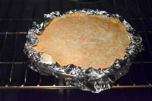 pie in oven with foil
