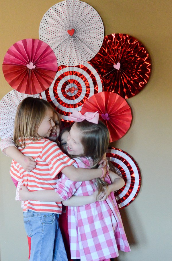 Paper fan backdrop for a Galentine's party for little girls - The Gifted Gabber