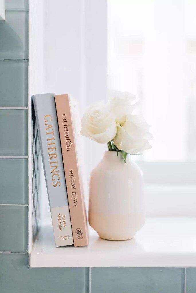 Keeping a couple of pretty cookbooks on the kitchen window ledge is handy and beautiful!