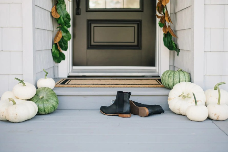 The front step is decorated with a neutral color palette for fall at The Ginger Home