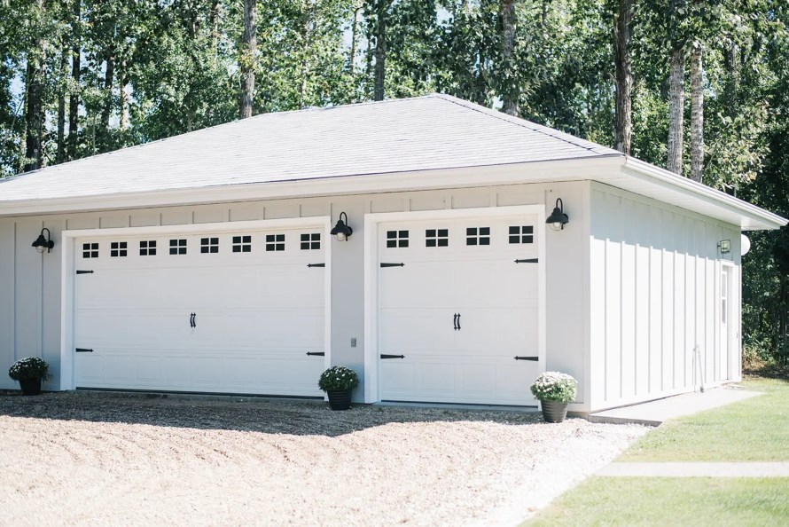 Garage with grey siding and roof and carriage style doors!