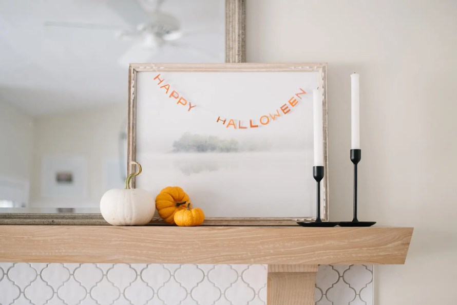 A Happy Halloween mini banner adds a subtle touch to the mantle!