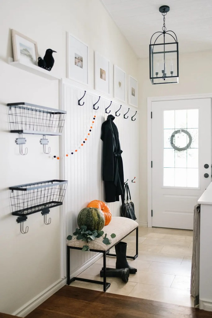 touches of halloween in a farmhouse entryway