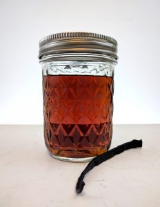 vanilla infused gin in a jam jar
