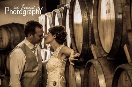Bride & Groom in Wine Cellar – Photo credit Lee Speary Photography