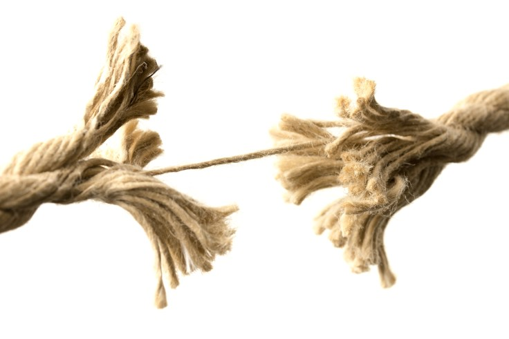 Rope splitting apart held together by one thread