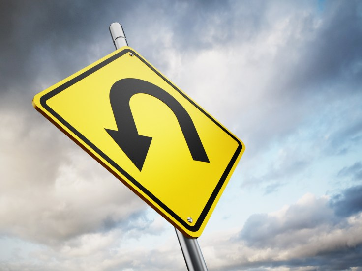 U turn road warning sign